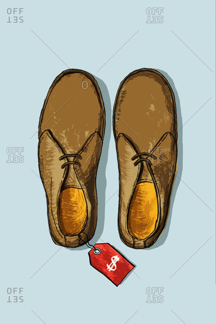High angle view of shoes with sale tag on blue background