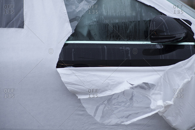 Close-up of torn cover on car