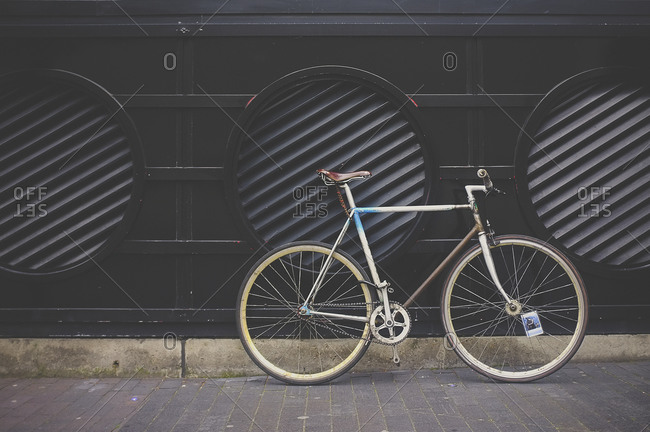 Bicycle parked on sidewalk