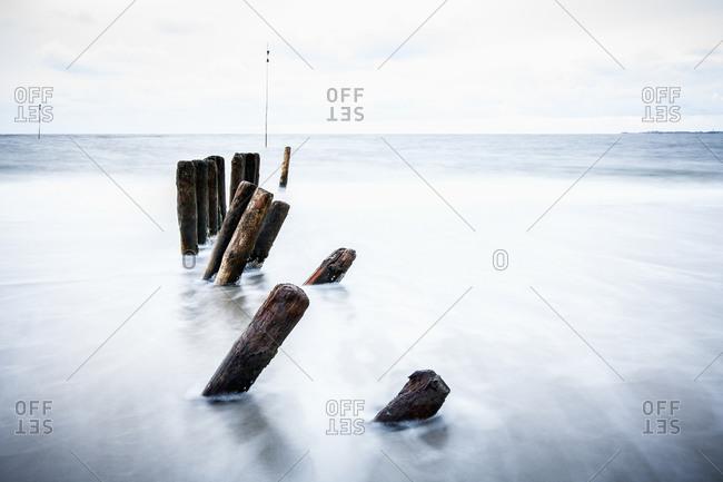 Wooden posts in sea, Amrum