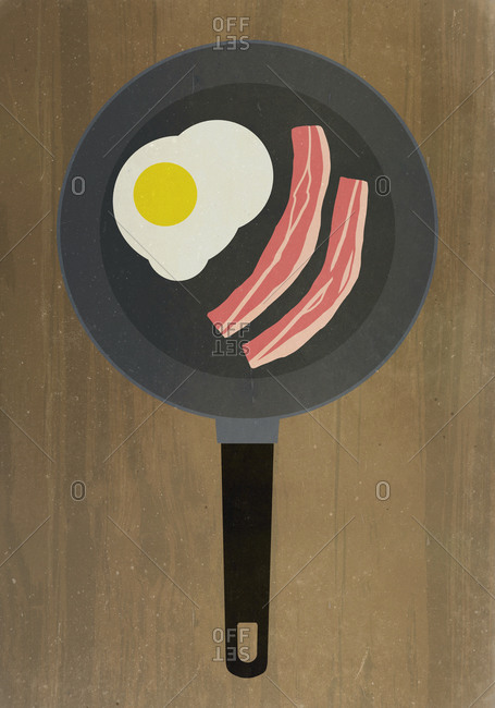 Bacon and egg in frying pan