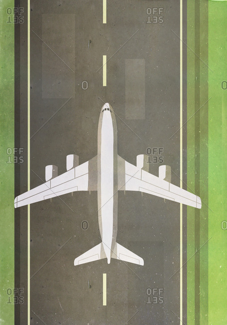 Overhead view of airplane landing on runway