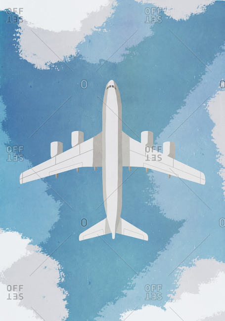 Overhead view of airplane flying in sky