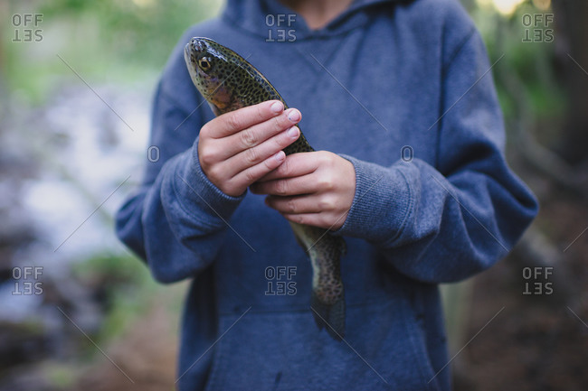 Midsection of girl holding a fish