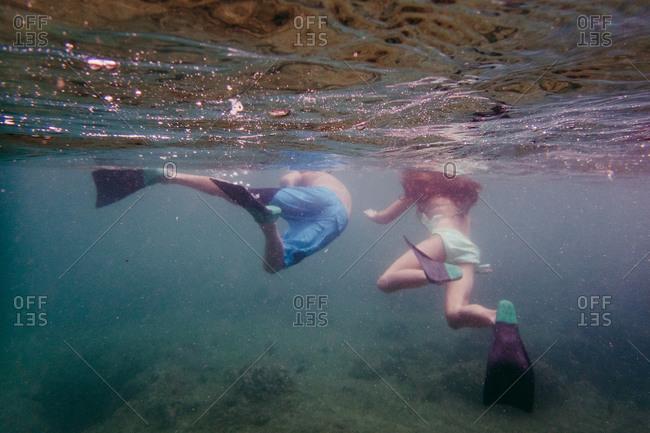 Underwater view of kids swimming