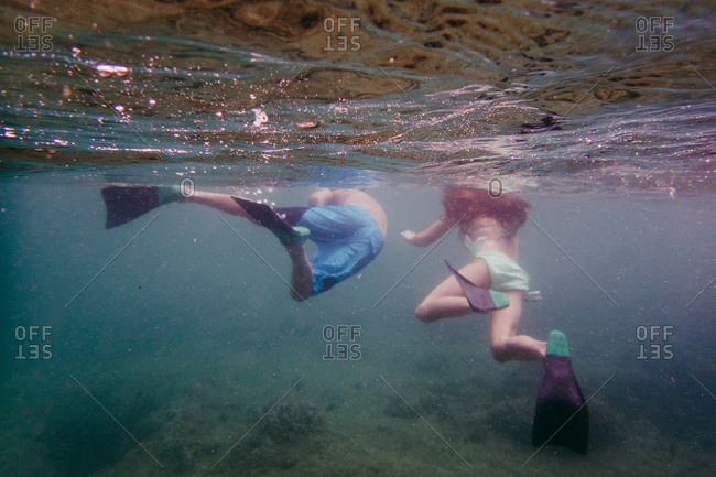 Underwater view of kids swimming
