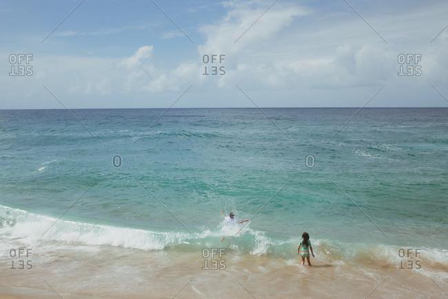 Kids playing in ocean waves