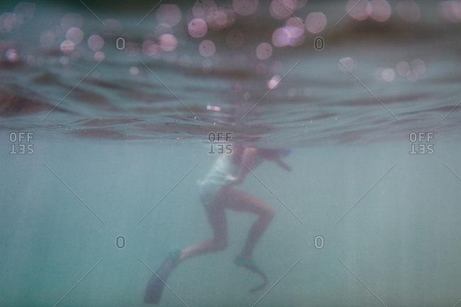 Underwater view of a girl swimming