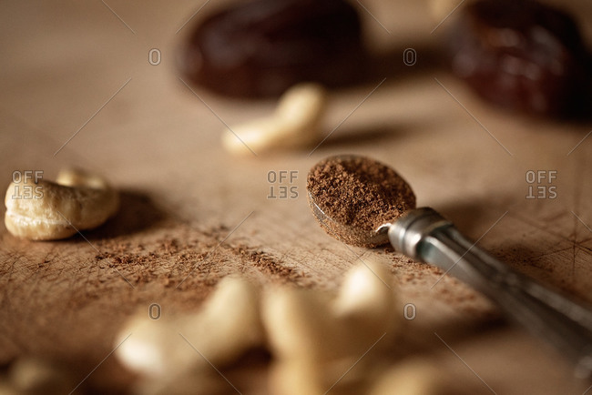 Spoon with powder and cashews