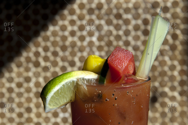 A Bloody Mary garnished with watermelon, celery and lime