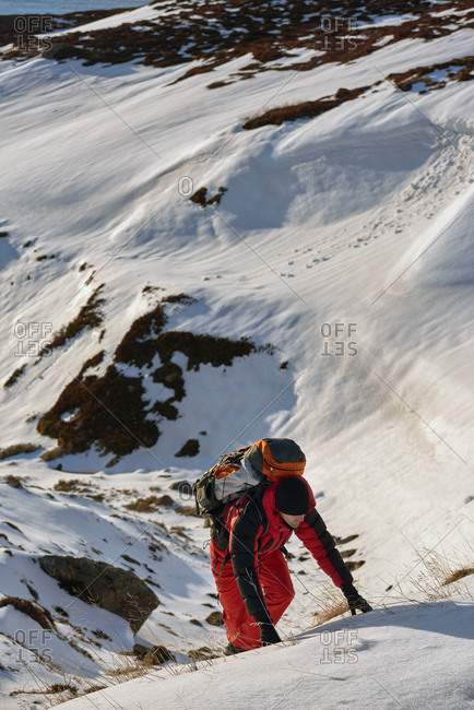 Man hiking snowy Icelandic mountain