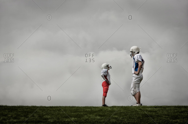 Two American football players facing each other