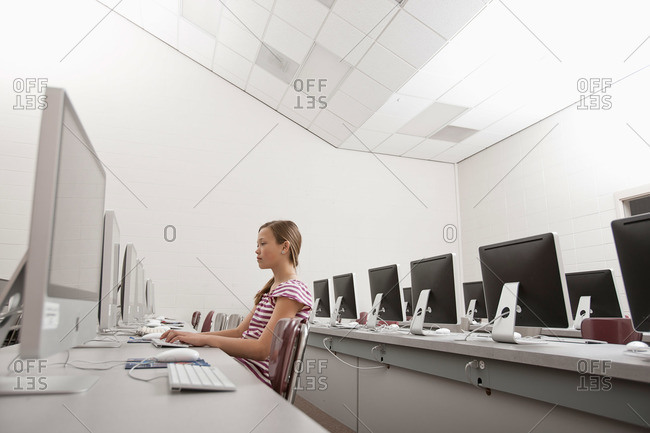 A young woman seated working in a computer room