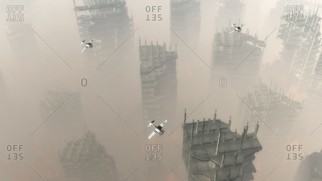 Planes flying over demolished buildings in a hazy war zone