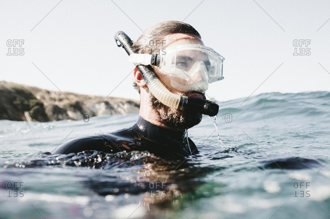 Man in ocean with snorkel gear