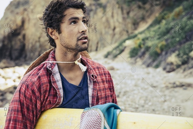Man in casual clothes with surfboard