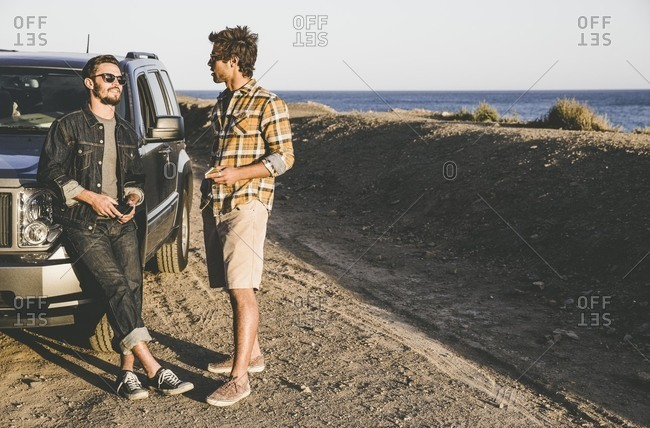 Men at SUV by the ocean