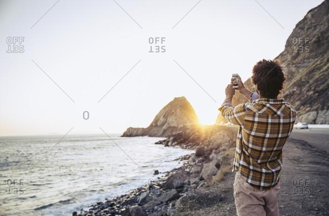 Man taking a selfie at the beach