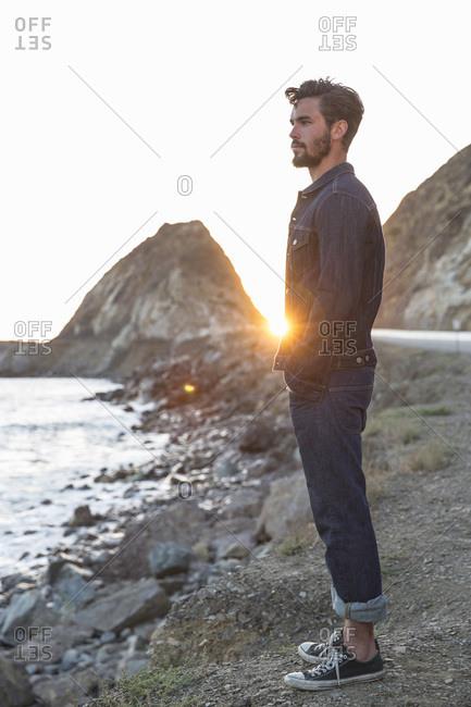 Man in denim on a beach