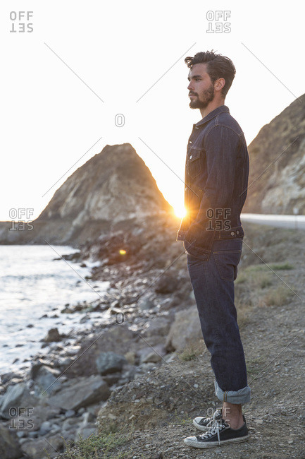 Man in denim on a beach