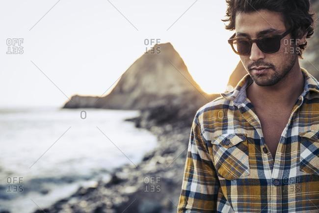 Still man on beach in sunglasses