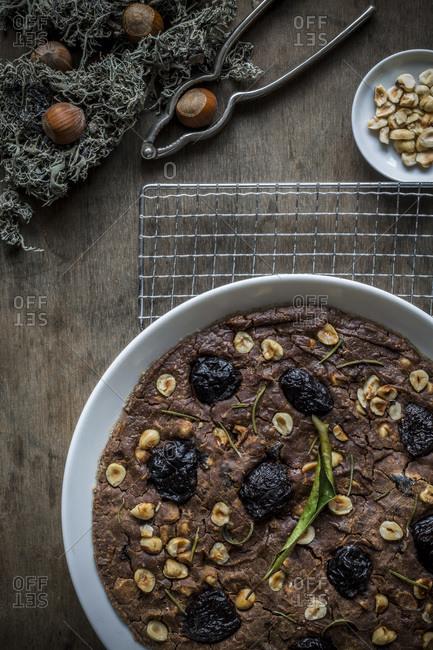 Festive Mediterranean Chestnut Flour Cake in white dish on cooling rack