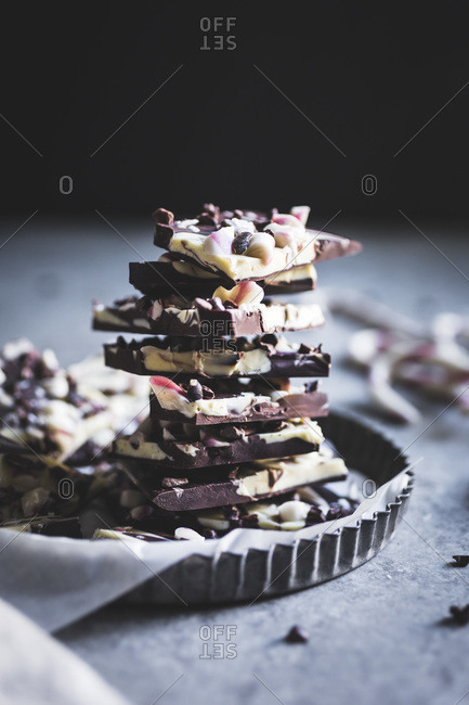 Stack of all-natural dark chocolate peppermint bark with cacao nibs and flaky salt