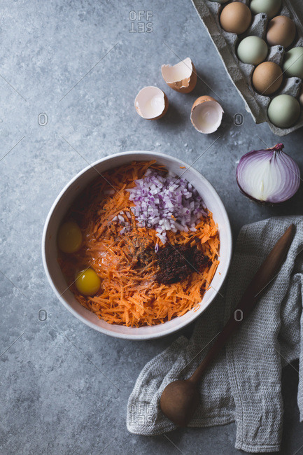 Ingredients for harissa sweet potato latkes, gluten-free in a bowl