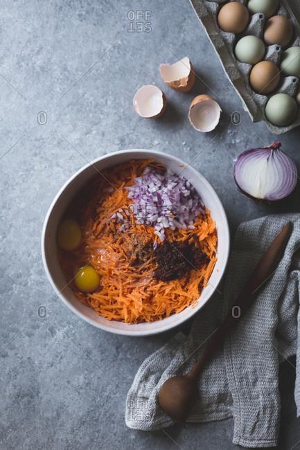 Ingredients for harissa sweet potato latkes, gluten-free in a bowl