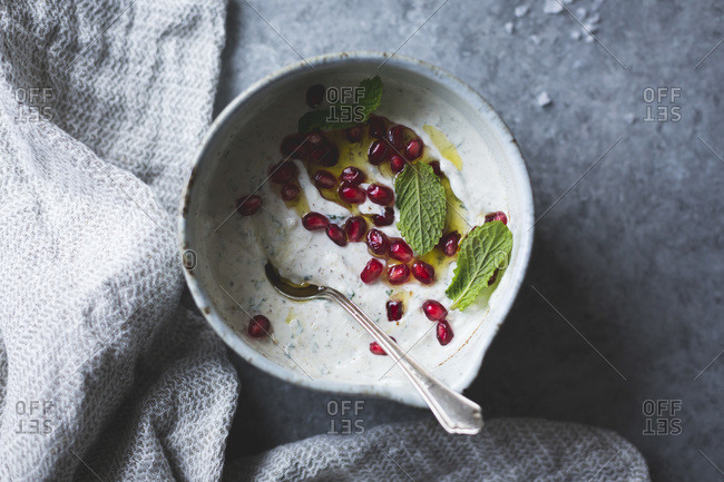 Close up of spiced garlic yogurt dip with mint