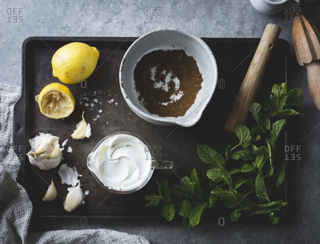 Ingredients for spiced garlic yogurt dip with mint