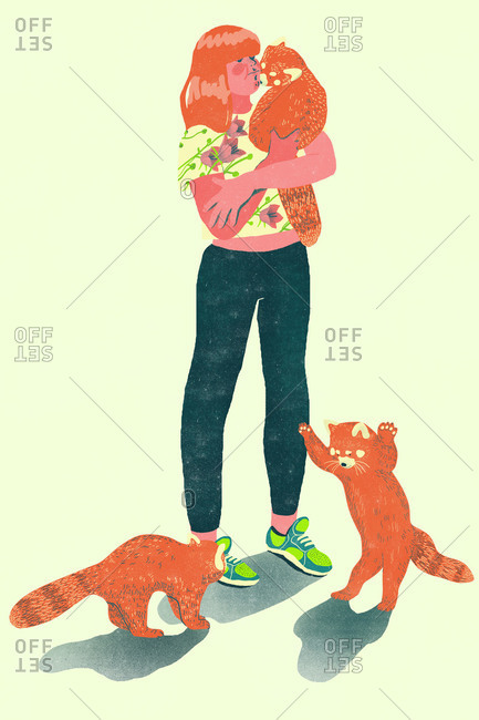 A redhead girl with red pandas