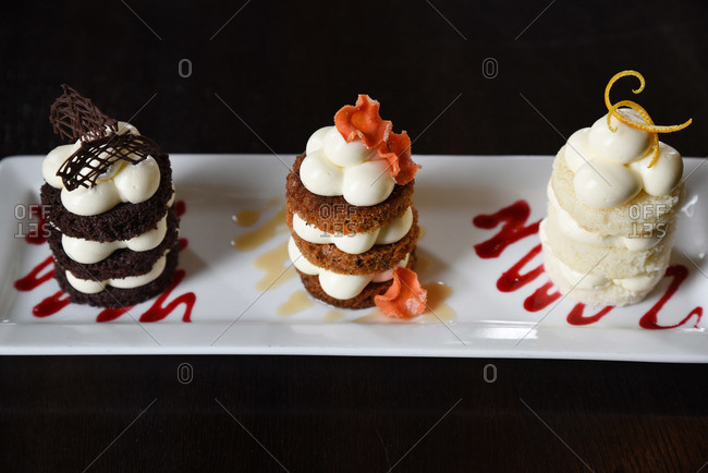 Three mini cakes on a dessert plate