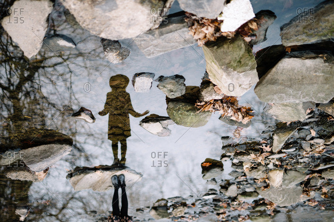 Girl's silhouette in a puddle