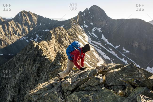 A man climbing Little Bear Peak, Alamosa, Colorado
