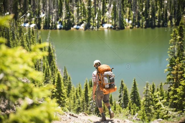 A backpacker hiking near a high alpine lake