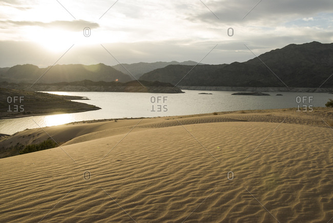 Setting sun over Lake Meed and the sand dunes near the shoreline