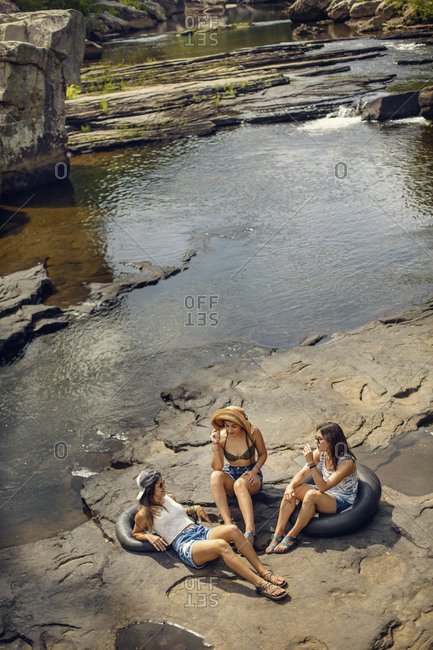 Three young women hike and play in the water at Little River Canyon National Reserve