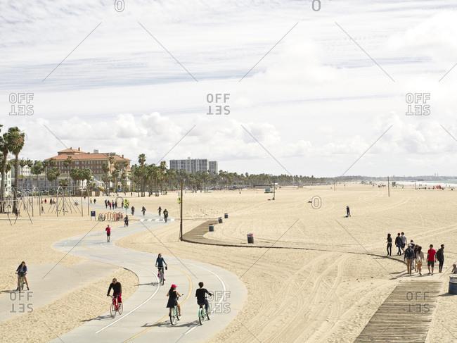 Santa Monica, CA, USA - February 28, 2015: People enjoying a nice day on the Santa Monica Boardwalk