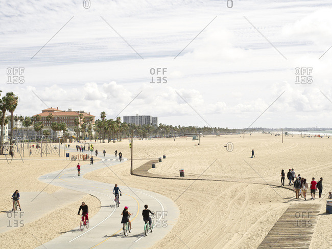 Santa Monica, CA, USA - February 28, 2015: People enjoying a nice day on the Santa Monica Boardwalk