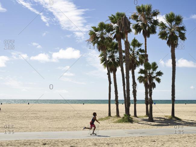 Santa Monica, CA, USA - February 28, 2015:Man skateboarding on the Santa Monica Boardwalk
