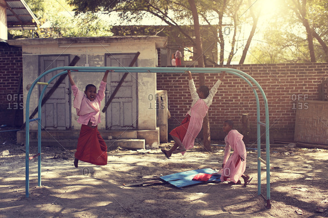 Mandalay, Myanmar - February 28, 2015: Students in the monk school are playing in the school yard