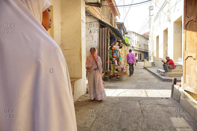 Zanzibar, Tanzania, East Africa - February 6, 2015: Woman wearing Kanga, in Stone Town, Zanzibar, Tanzania, East Africa