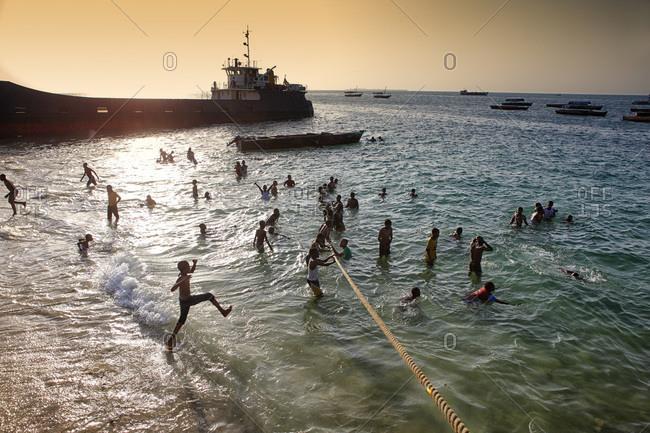 Zanzibar, Tanzania, East Africa - February 6, 2015: Children bathing on the beach. Stone Town. Zanzibar