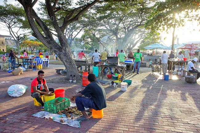 Zanzibar, Tanzania, East Africa - February 6, 2015: Food vendors in front of the Casa de las Marabillas Stone Town in Zanzibar, Tanzania, East Africa