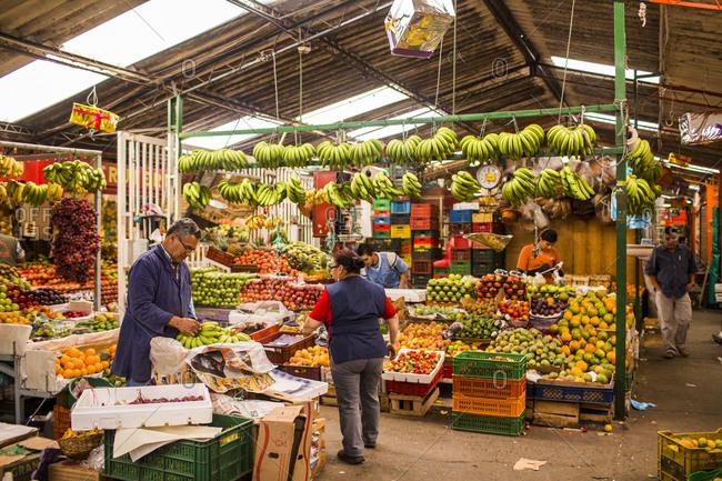 Bogota, Colombia - December 3, 2013: Food venders at the Plaza de Mercado de Paloquemao in Bogota, Colombia