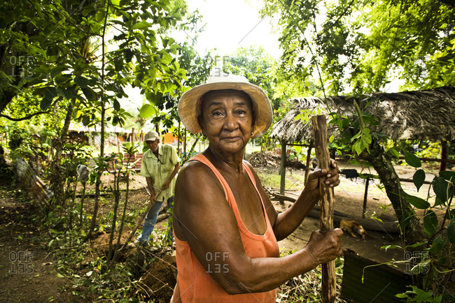Costa Rica - June 15, 2015: A woman takes a break from tending to her property in Costa Rica