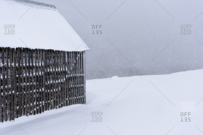 Side of a house in an Iceland blizzard