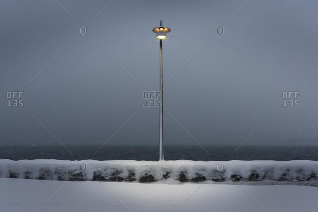Lone light pole in a snowfall in Reykjavik, Iceland