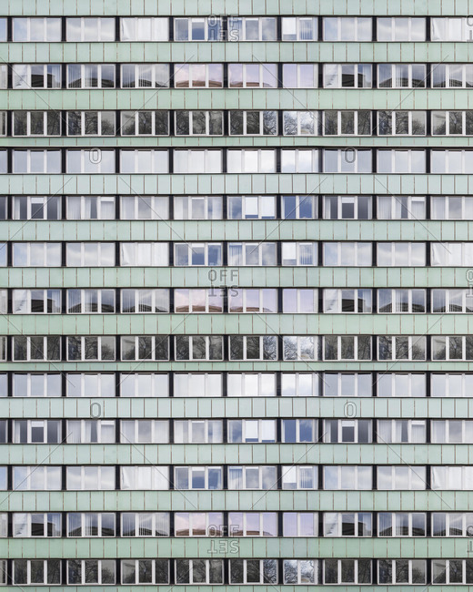 Full frame view of rows of windows on an apartment building